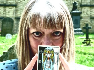 Picture of Vivienne holding High Priestess Tarot Card